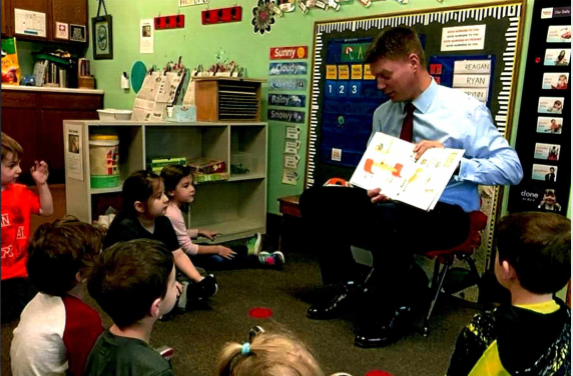 Nicholas D Potthoff - Community Involvement reading to classroom of children